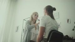 Feminine beauty. Beauty stidio. Make-up artist and model Stock Footage