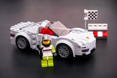 Lego Porsche 918 Spyder with driver on black background. Kuvituskuvat