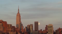 Full Moon rising next to the Empire State Building at Sunset Time-Lapse Stock Footage