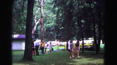 1971: families walking toward picnic area at park while talking and visiting Stock Footage