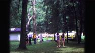 1971: families walking toward picnic area at park while talking and visiting Stock Footage