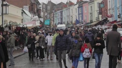 Tourists Walking at Portobello Road Market in London, United Kingdom. Stock Footage