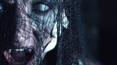 4k Halloween Shot of a Horror Woman Mermaid Turning fast with White Eyes Stock Footage