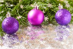 Fir tree branch and Christmas toys bauble with confetti Kuvituskuvat