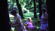 1971: ladies chatting joking with one another at relaxing outdoor park  Stock Footage
