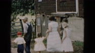 1957: man leading group down path and into an old building HICKSVILLE, NEW YORK Stock Footage