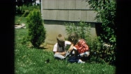 1957: kids are playing outdoor of the house HICKSVILLE, NEW YORK Stock Footage
