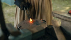 Blacksmith Forges Metal. Slow-mo Stock Footage