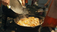 Cooking Pilaf In Cauldron Outdoors. Slow-mo Stock Footage