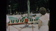 1957: children enjoy bumpy ride on amusement resembling caterpillar HICKSVILLE Stock Footage