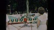 1957: children enjoy bumpy ride on amusement resembling caterpillar HICKSVILLE Stock Footage