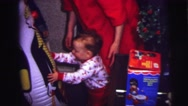 1973: child in pajamas playing with an inflatable toy LYNBROOK, NEW YORK Stock Footage