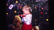 1973: child is sitting on toy while sucking on an object LYNBROOK, NEW YORK Stock Footage