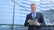Businessmen using digital tablet computer touchscreen Stock Footage