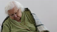 Real footage of old lady fall asleep while sitting Stock Footage