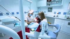Procedure of dental treatment to the patient in dentistry Stock Footage