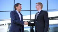 Two businessmen shaking hands Stock Footage