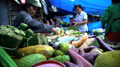 Bali, Indonesia - Balinese street market selling fresh fruit  Stock Footage