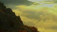 Beautiful summit sunrise dawn above flowing foggy misty waves in the mountain Stock Footage