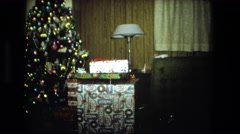 1974: christmas tree and presents under it FORT WAYNE, INDIANA Stock Footage