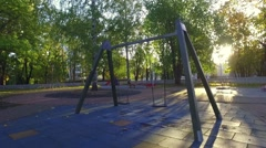 Empty playground swings. Camera around. Slow motion. Stock Footage