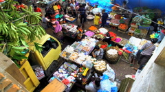 Bali, Indonesia - City street scene of Asian female trader selling Stock Footage