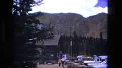 1974: cars are parked in parking lot outdoor cabin in the mountains. FORT WAYNE Stock Footage
