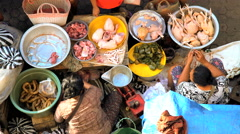 Bali, Indonesia - Local people and tourists buying fresh chicken Stock Footage