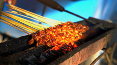 BBQ satay chicken on skewers cooking over hot coals selling on local street Stock Footage