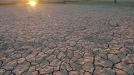 Sunset above drought disaster, dry soil. Climate change, global warming Stock Footage