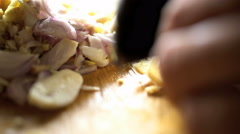 Hands chopping healthy raw vegetables and spices with traditional Balinese Stock Footage
