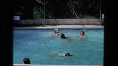 1974: people swimming and playing in the pool FORT WAYNE, INDIANA Stock Footage