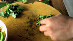 Asian chef cutting healthy green vegetables with knife on wooden chopping board Stock Footage