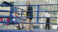Kids boxing coach instructs the boxer about the tactics and style Stock Footage