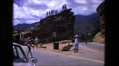 1974: people roaming rock formations showing interest in the place around them Stock Footage