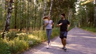 Young couple training together in nature Stock Footage