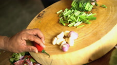 Chef in class kitchen chopping selection of healthy raw vegetables with knife on Stock Footage