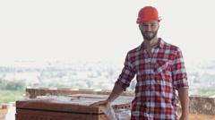 Builder okays building materials Stock Footage