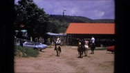 1974: several people ride horses at western style park FORT WAYNE, INDIANA Stock Footage