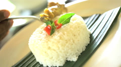 Oriental low calorie diet of steamed sticky white rice displayed by chef in Stock Footage