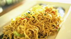 Balinese local fried noodle dish of Mie Goreng displayed on nutritious Banana Stock Footage