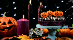 Halloween party table with spooky hand with long black nails Stock Footage