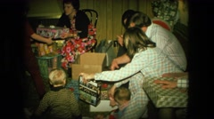 1974: family unwrapping christmas presents FORT WAYNE, INDIANA Stock Footage
