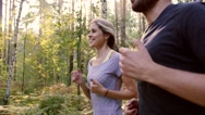 Close-up of two young people enjoying their gentle morning run Stock Footage