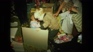 1974: little boys opening christmas presents FORT WAYNE, INDIANA Stock Footage