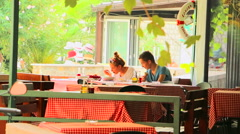 Young couple having lunch on the terrace of restaurant Stock Footage