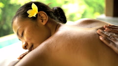 Holistic massage treatment on young Asian female relaxing on vacation at luxury Stock Footage