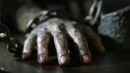 Women's fingers with dirty fingernails and burned skin. female hand shackled. Stock Footage