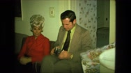1974: man is trying to figure out how his camera works FORT WAYNE, INDIANA Stock Footage