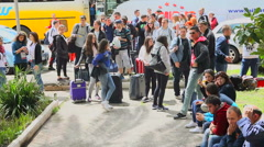 Students carry bags and luggage and stand in front of the university campus Stock Footage
